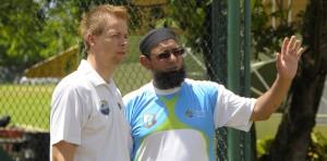 Saqlain Mushtaq (right) makes a point to the Sagicor West Indies High Performance Centre's head coach Graeme West.