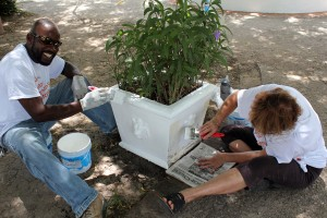 Elson Toppin and Gloria Hutchinson busy on this pot.