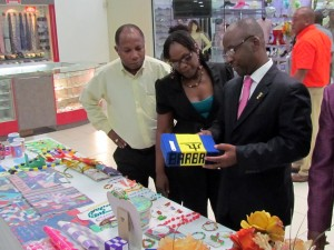 Minister of Sport, Youth and Culture, Stephen Lashley touring the summer camps display with other Ministry officials.