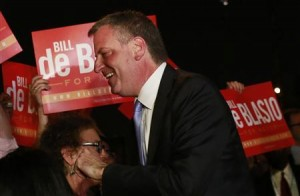 Democratic candidate for New York City mayor Bill de Blasio with supporters yesterday.
