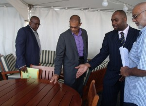 From left, Guyana Consul General, Michael Brotherson; Permanent Secretary in Barbados' Ministry of Foreign Affairs, Charles Burnett; Go-Invest Officer, Shawn Doris; and Managing Director of Guyana wood furniture firm Guy-America,  Mohamed Alli, look at a wooden table made by the company