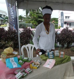 Kellyann Allicott with her natural bath soaps in wrappings from nature such as banana leaves.