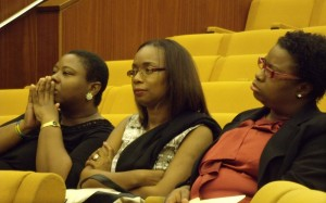 Persons attending the panel discussion. At left is Andrea Holder, who led the evening's event in prayer.