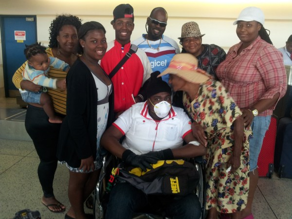 Joshua Sobers-Henry accompanied by mother Carolann Sobers-Skeete (right) and Variety Club executive director Donnah Russell at the Grantley Adams International Airport.