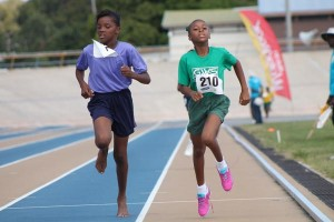 Bryeisha Worrell of St Catherine's Primary (left)and Jade Roberts of St Philip's battling to the finish line in the 600m open which Worrell won.