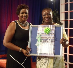 Monica Worrell, right, wife of Central Bank Governor, Dr DeLisle Worrell, was presented with a surprise birthday gift by Legal Secretary, Sadie Dixon, at the conclusion of the Banks inaugural Caribbean Economic Forum at the Grand Salle last night.