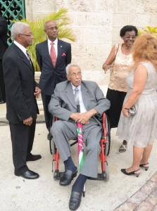 Former MP Gilmore Roachford (wheel chair) could not miss           the ceremony today.
