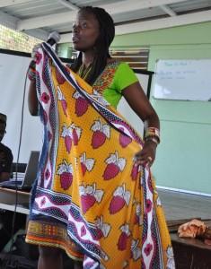 Kenyan Sandra Ochieng-Springer demonstrating how to wrap a skirt.
