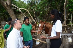 JADA Group general manager Paul Lewis (left) interacting with Latoya Lane (right),  director of the Girl to Girl project, at the Nature Fun Ranch (NFR) as Anderson Gill  (centre), also a member of the ranch, looks on.