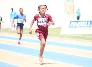 Shamyah Alleyne of Hilda Skeene heads for the finish line in the 400M.