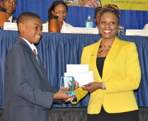 Jermaine Als from Harrison College who placed second as he accepted his prizes.