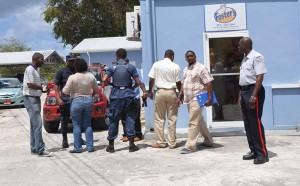 Police investigators were busy on the scene following this morning's robbery.
