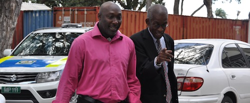 "Journalist Barry Alleyne (l) and attorney Ezra Alleyne heading to District ""A"" Police Station."