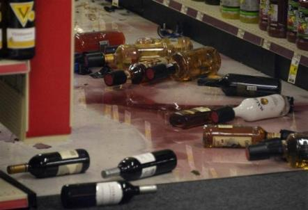 Bottles of alcohol are seen on the floor after falling off the shelves at a CVS pharmacy during a magnitude 5.1 earthquake in Fullerton, California.