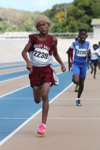 Kemar John of Wesley Hall Juniors showed great determination to win the open boys' 800M.
