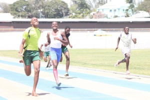 Kevon St Juste of Barnett House got the better of senior victor ludorum Kadeem Maynard in the under-20 boys' 200M.