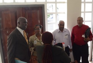 Minister Michael Lashley (left) chatting with Transport Board managers ahead of the meeting.