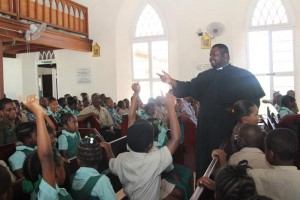 Reverend Davidson Bowen gets students to interact with him during his sermon.
