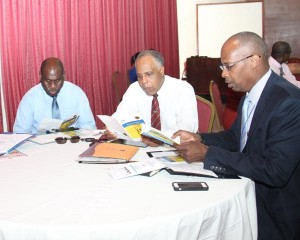 Some of the participants at the SBA workshop (from left) Barry Blenman, operations supervisor of business devleopment at the Barbados Stock Exchange; Ricky Went, general manager of Axcel Finance; and CEO and general manager of the Barbados Stock Exchange, Marlon Yarde.