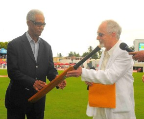 Sir Garry Sobers accepts the bat used by Sir Conrad Hunte in the Tied Test. (Photo courtesy WICB)