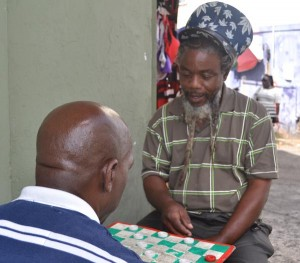 Philip Blunt (right), playing draughts with a friend, is of the mindset people should live a more righteous life.