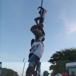 Scarborough young men conquering the Oistins greasy pole.
