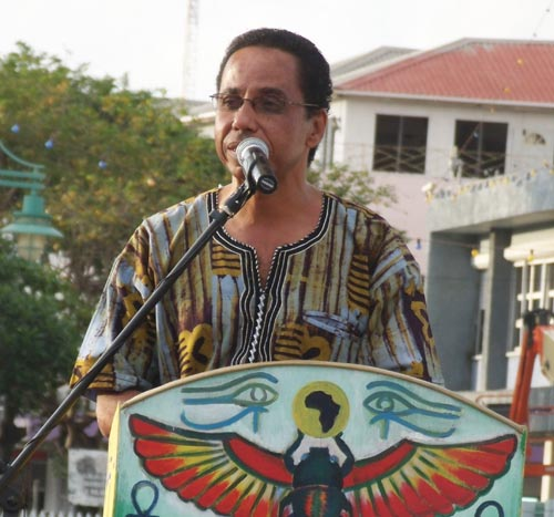 President of the Clement Payne Movement, David Comissiong, addressingthe tribute to Kamau Brathwaite concert.