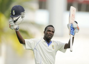 Jonathan Carter acknowledges the crowd on reaching his century.
