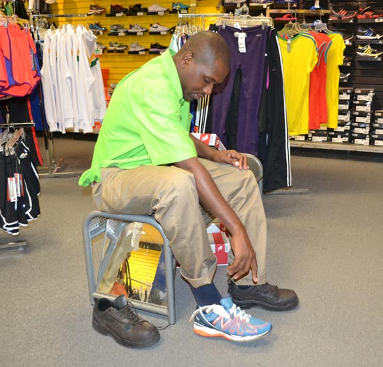 Rodney Cadogan trying his new sneakers, which he hopes to help him on his journey to a possible record two million steps.
