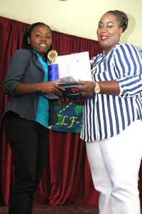 One of the top performers, Shanice Connell receiving her prizes from former student Chrystal Cummins–Beckles.