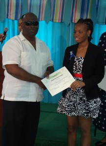 BCD vice-president, Roger Vaughan, presents a certificate to a Breakfast Club graduate at this morning ceremony.