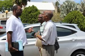 BWU Assistant General Secretary, Dwaine Paul (L) speaking with colleagues Orlando Scott and Sean Scott.