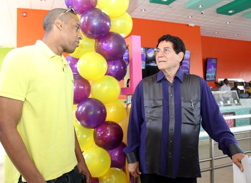 Marketing manager for Power Broadcasting Richard Haynes (left) and founder of Chefette Restaurants Assad Haloute during the opening of the restaurant's 15th branch.
