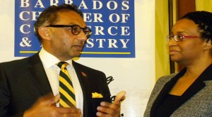 Minister of Trade, Industry and Investment, Senator Vasant Bharath (left) chatting with president of the Barbados Chamber of Commerce and Industry Tracey Shuffler.
