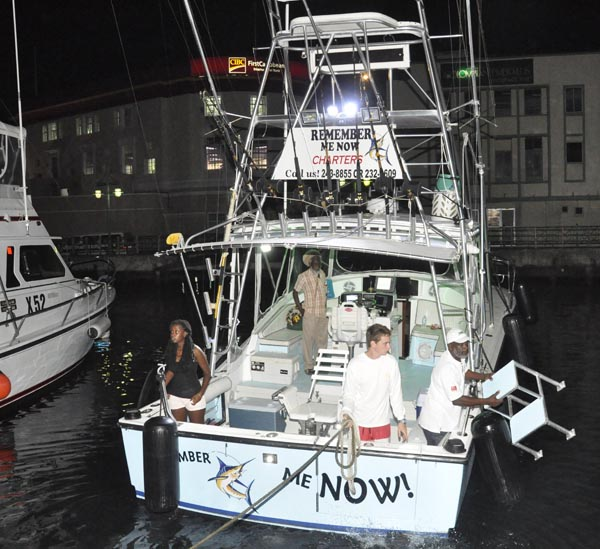 Crew members (from left) captain Rianna Thompson, Johnny Blades, Luke Hutson and Roy Thompson preparing to sail out of Barbados on Wednesday night.