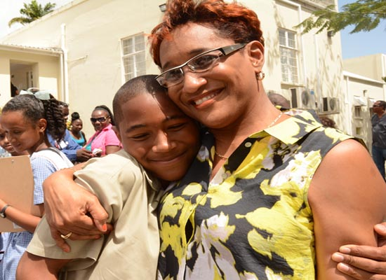 Brandon Watson of  St Cyprian Boys hugging his mother Alison after the examination at  The St Michael School.