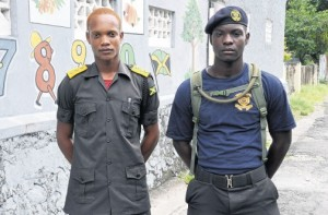 Jamar Briscoe (right) and Jovanne McLean said their cadet training helped them to assist in putting out the fire on a century-old building in Buff Bay, Portland.