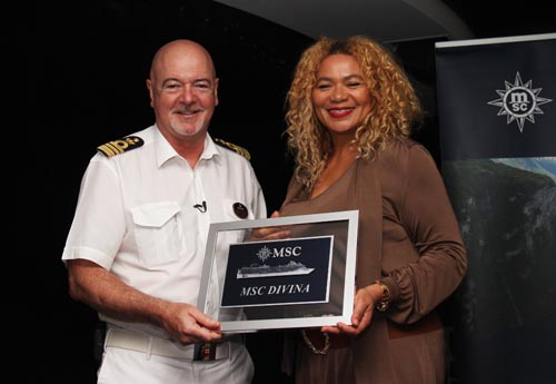 Interim president and CEO of the Barbados Tourism Authority Petra Roach accepting a plaque from Captain Pier Paola Scala on the inuagural visit of the MSC Divina.
