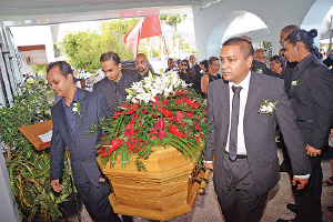 Pallbearers carry the casket bearing the body of murdered Senior Counsel Dana Seetahal into the Aramalaya Presbyterian Church