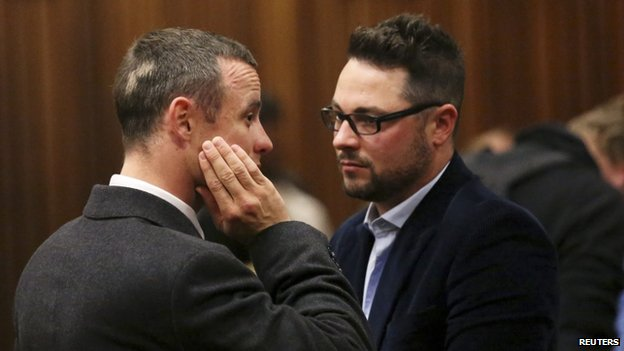 Pistorius spoke to his brother Carl (right) after getting the details of his psychiatric assessment.