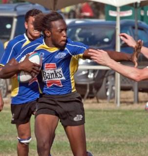 Sean Ward (with ball) scored three tries against the Balmy Beach Rugby team.