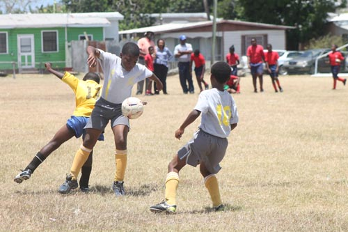 St. Giles' midfielder Amon Griffith showing good ball control.