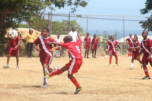 Striker Chewee Griffith blasting home a goal for St Stephen's Primary.