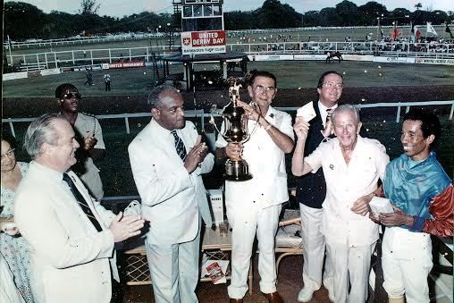 George Davis celebrating with the 1989  Barbados Derby Cup, along with (from left) the late Tommy Peirce, Sir Hugh Springer, George Challenor, the late Bill Marshall and jockey Venice Richards.