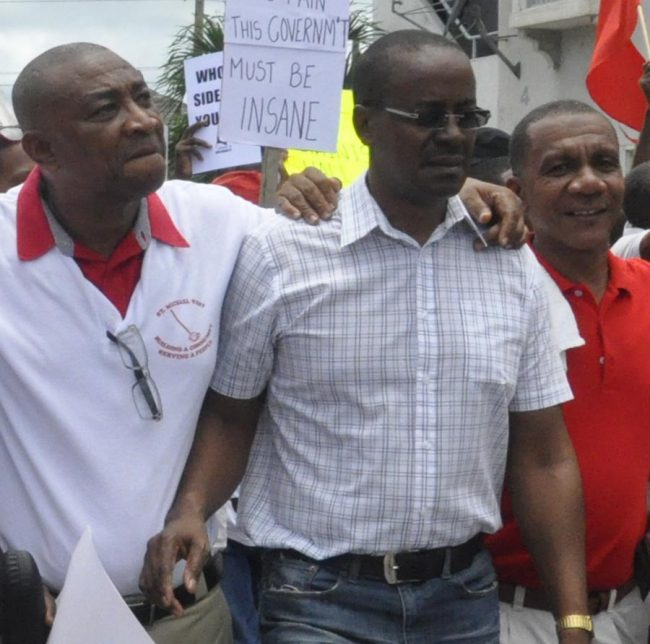 From left: BLP members Reverend Joseph Atherley, Clyde Mascoll and David Gill took part in today's march.
