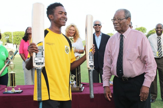 Raynaldo Estwick of Foundation all smiles after receiving his prize from Sir Everton Weekes for the batsman with the highest individual score in the tournament - 136 not out.
