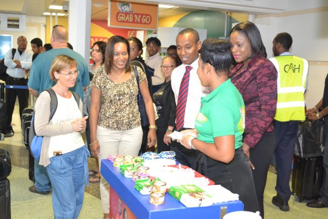 LIAT flyers being treated to samples of Bryden Stokes snacks.