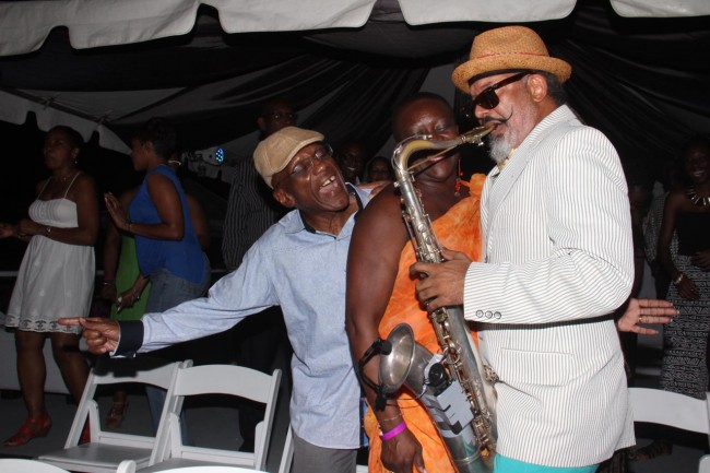 Central Bank Governor Dr Delisle Worrell (left) and his wife (centre - partially hidden) enjoyed the sweet sounds.