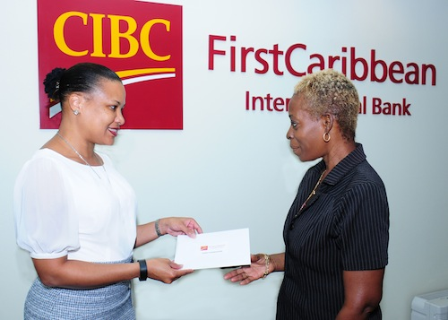 Donna Wellington, managing director, Barbados, CIBC FirstCaribbean (left) speaks with Sandra Simmons of the Hope Foundation after presenting the foundation with funds to support its education and outreach on chronic diseases.