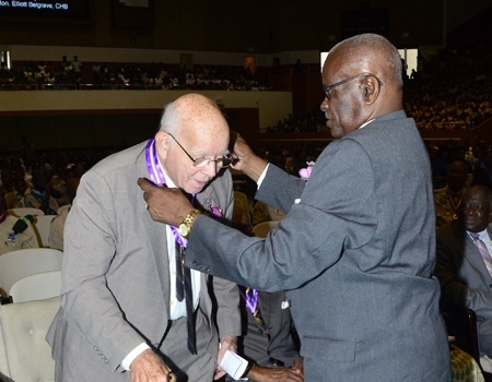 The late Sir Denys Williams (left) as he was being honoured by then-Acting Governor General Sir Elliott Belgrave two years ago.